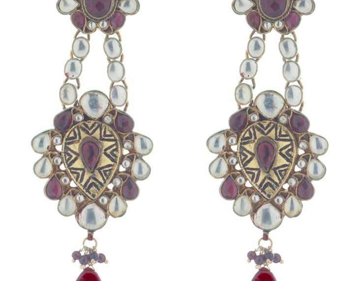 Exquisitely designed #Kudnan #earrings, featuring red stone. This grand pair of danglers will instantly glam up any traditional attire.