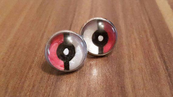 Pokeball earrings  https://www.etsy.com/uk/listing/267652225/pokemon-pokeball-stud-cabachon-earrings