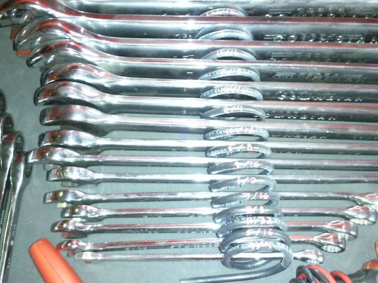 Coil Spring Wrench Organizer by 91bronc300 -- Homemade coil spring wrench organizer utilizing a red paint marker to indicate wrench sizes. http://www.homemadetools.net/homemade-coil-spring-wrench-organizer