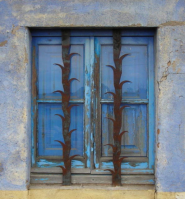 Blue Window With Decorative Security Bars