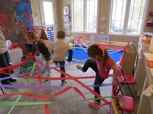 """Friday Fun! Let your preschooler weave through a rainbow, which will encourage balance, motor planning, coordination and body awareness. You can even read """"A Rainbow of My Own"""" to go with the activity."""