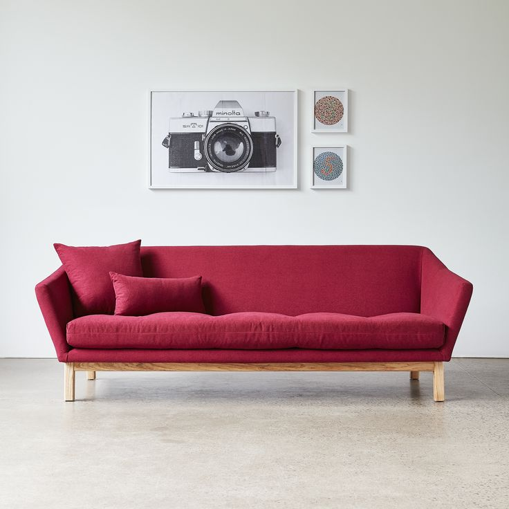 Astrid Sofa - Stockholm Merlot | The Astrid Sofa is a contrast of curves and angles, combining slender, sloping armrests and a button-tufted seat cushion with an elevated truss-style exterior wood frame. | Gus* Modern