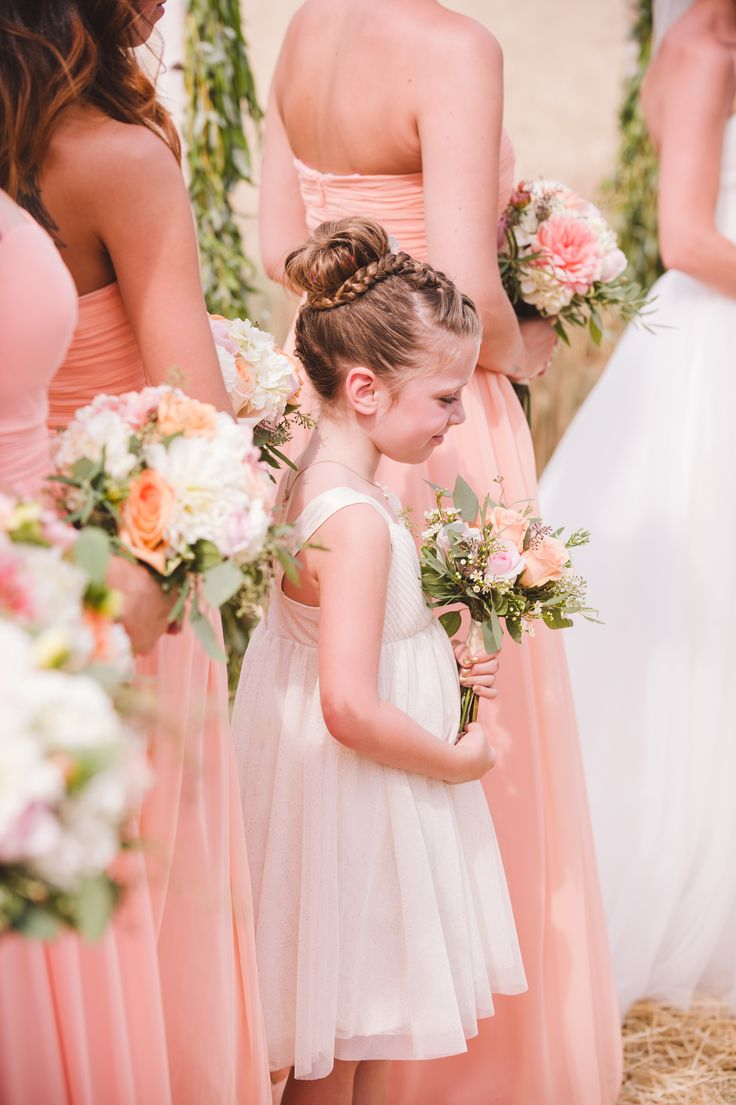 #bridesmaids #flowergirl #wedding #ceremony #florals #bouquet #peach #donnamorgan #long dresses