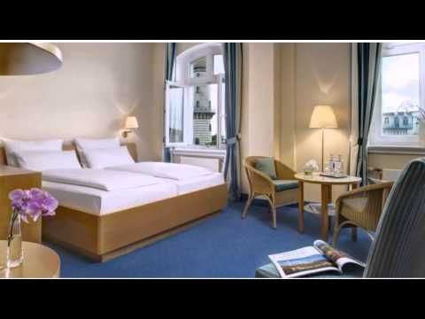 Hotel Am Leuchtturm - Rostock-Warnemünde - Visit http://germanhotelstv.com/am-leuchtturm This non-smoking hotel is set on the beach at Rostock-Warnemünde. It offers Baltic Sea views and soundproofed rooms and apartments. The centre of Warnemünde is just a few minutes' walk away.  The Hotel Am Leuchtturm is the oldest hotel in Warnemünde. -http://youtu.be/ZdFOJ1QxMnw