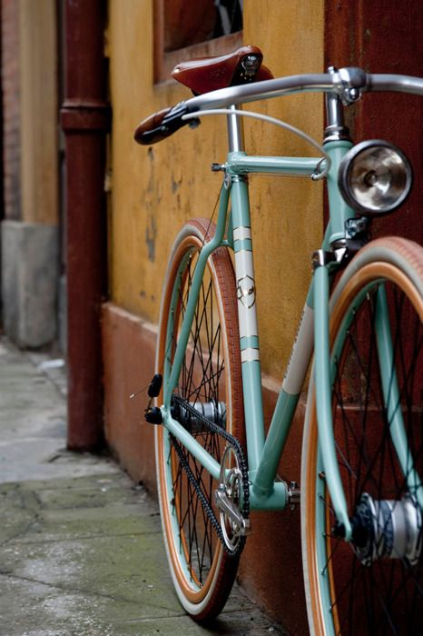 light blue with brown bike