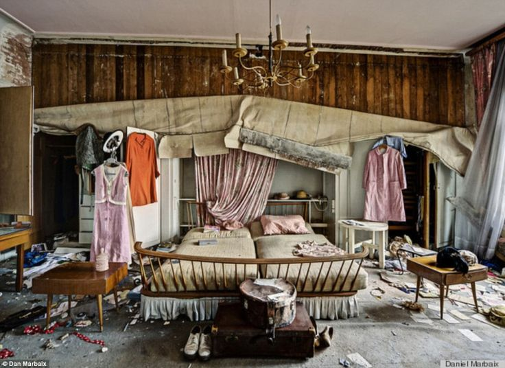 The bedroom: There are 50s-style dresses, hats, shoes and suitcases scattered around what was presumably the house's master bedroom. Abandoned doctor's house, Germany.
