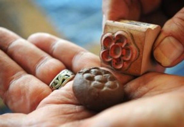 Torin Halsey/Times Record News   Each of the nine varieties of seed bombs are stamped with a different design to identify the wildflower spe...