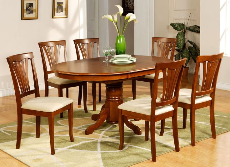 Treat yourselves to a new dinner table for Christmas. East West Furniture AVON5-SBR-C 5-Piece Dining Table Set, Saddle Brown Finish