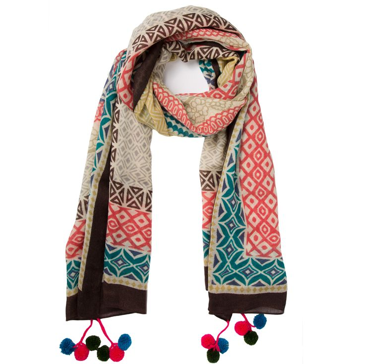 This multi-coloured pom pom scarf is perfect for adding a splash of colour and fun to your wardrobe during the winter months. The design is an interesting mix of both colours and prints and the playful contrasting coloured pom poms make it all the more joyful. The scarf is both long and wide which gives you lots of styling options. It could be worn inside as an accessory to jumpers ,shirts or dresses but would also look great partnered with a coat when the weather gets colder.