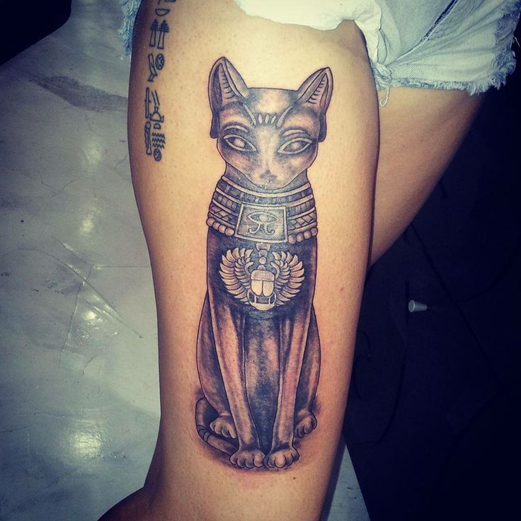 Egyptian hieroglyphs and cat tattoo in black