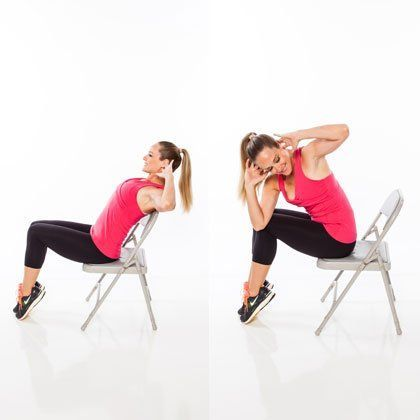How to do it: Sit tall with knees bent and together (focus on squeezing inner thighs together for more muscular activation), toes pointed, hands behind head. Brace abs in tight and hinge back until just shoulder blades are lightly touching the back of the chair. Bring body forward, crossing right elbow to the outside of left knee. Return to start. Repeat for 20 alternating reps.