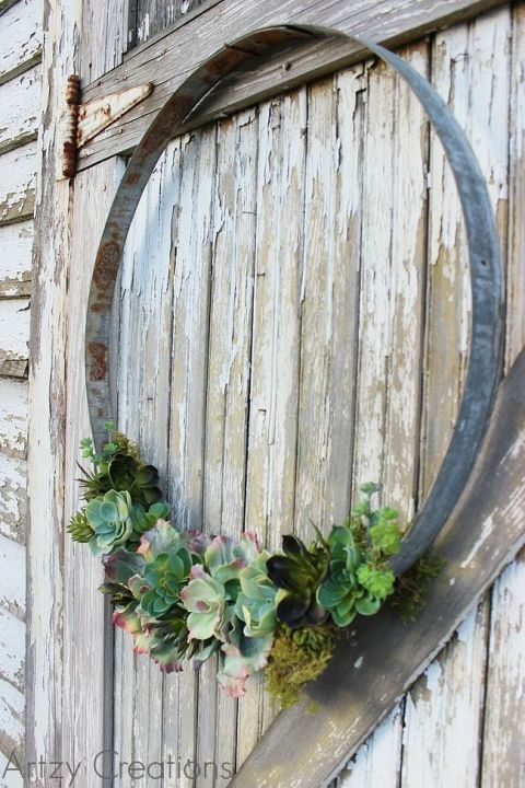 Make this DIY Wine Barrel Ring Wreath by adding succulents to the bottom.
