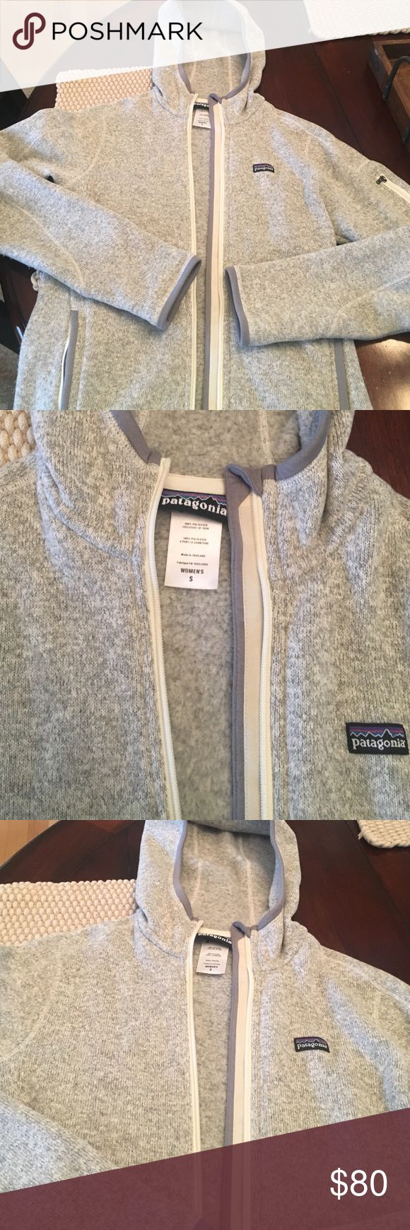 NWOT Patagonia women's jacket Adorable and cozy Patagonia women's zip up jacket with hood. Heathered gray/cream color. Never worn! Patagonia Jackets & Coats