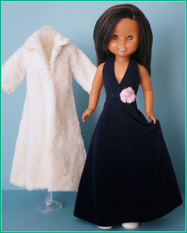Abrigo piel blanco y vestido negro largo