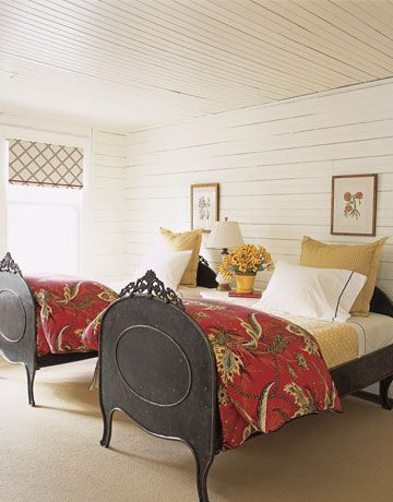 Guest room - wood walls, sisal rug, yellow accents - Tom Stringer
