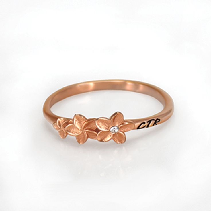 Plumeria CTR Ring   Made of rose gold and has the Hawaiian plumeria flower. Stainless steel.