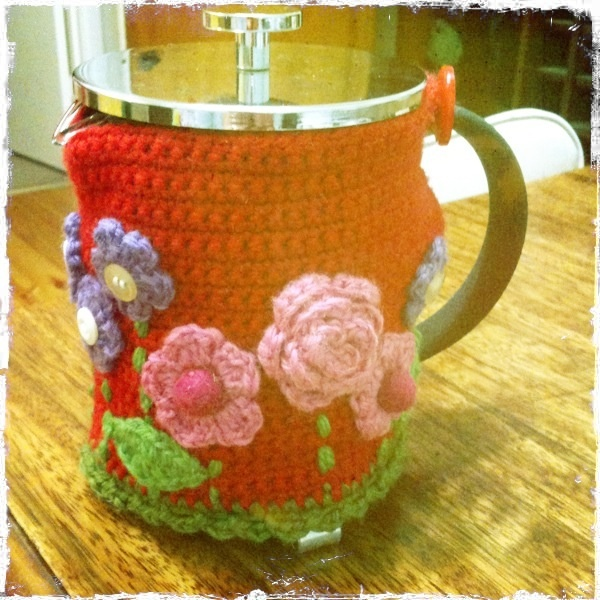 Bespoke crochet tea cosy with crochet flowers. By Lauren Bittner, Wangaratta