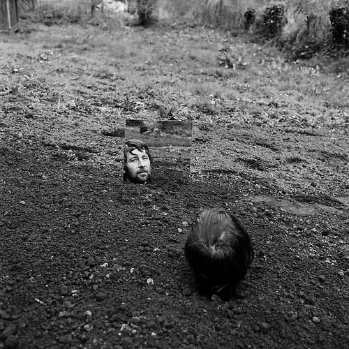 Keith Arnatt. 'Self Burial with Mirror'.1968.