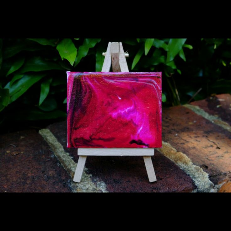 Introducing mini abstract paintings with mini easels. Hand poured acrylic paint on canvas. Easel included.  This one is now available. More to be added to my store real soon.