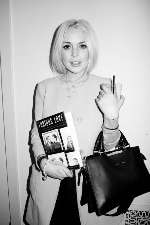 "Lohan: ""I am TOTALLY going to turn this whole thing around. You just wait and see. You WATCH. Who's got a cigarette?""    Lohan at the Chateau Marmont, photographed by Terry Richardson."