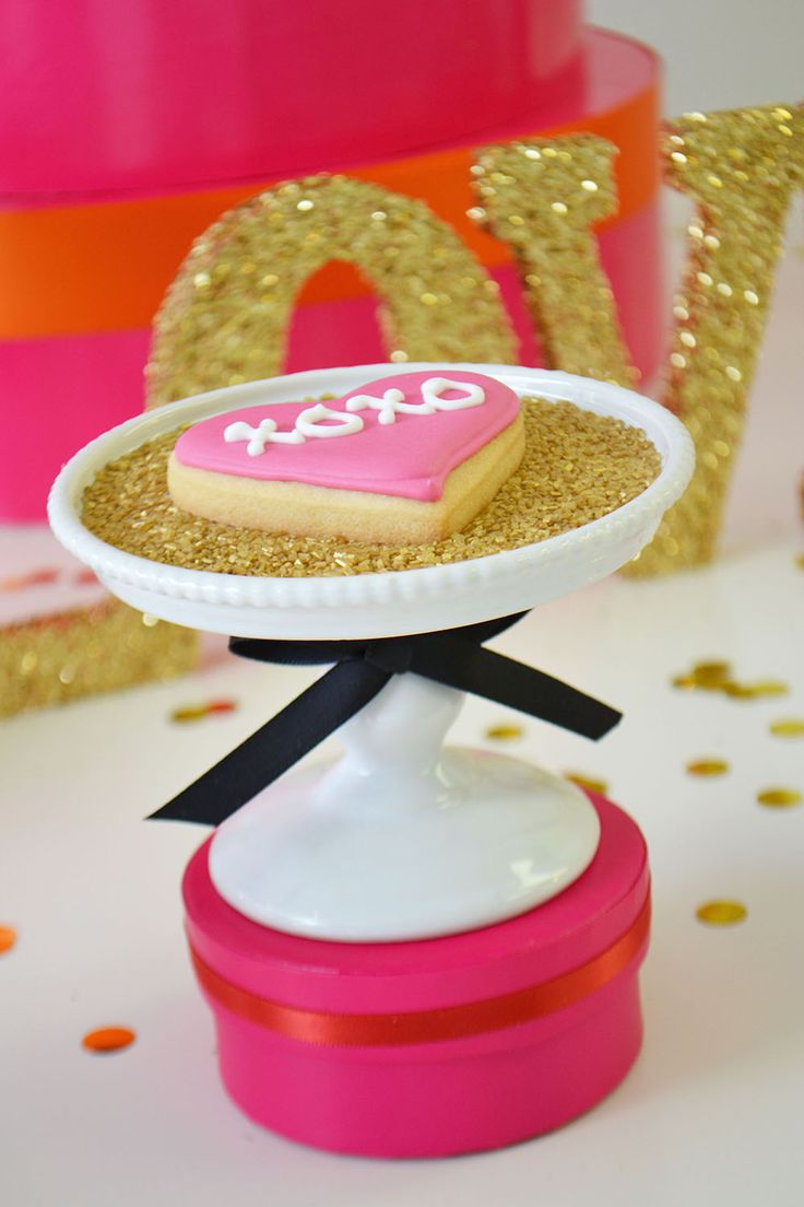 XO hot pink Valentine's sugar cookie and gold sprinkles by Bake Sale Toronto.