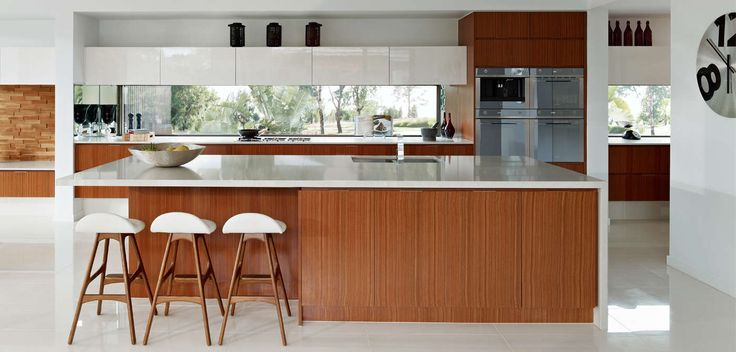 KITCHEN: Glossy white finishes capture the eye, honey timbers balance the juxtaposition. Visit our Scandinavian Lookbook style here: http://www.metricon.com.au/get-inspired/lookbook/scandinavian