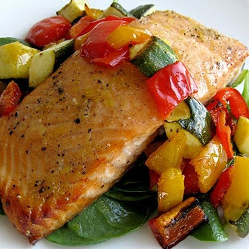 Honey Lemon Salmon With Roast Vegetables Over Baby Spinach