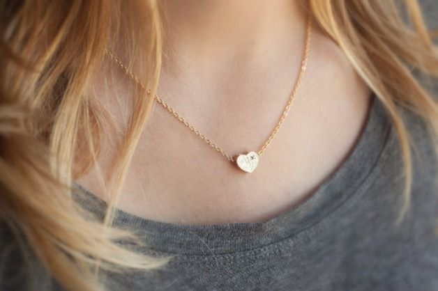 A lovely and delicate heart necklace, perfect for everyday or for bridesmaids gifts.  Item details:  ► Small gold dipped with tiny CZ diamond heart charm ► Chain is gold plated with a nice...