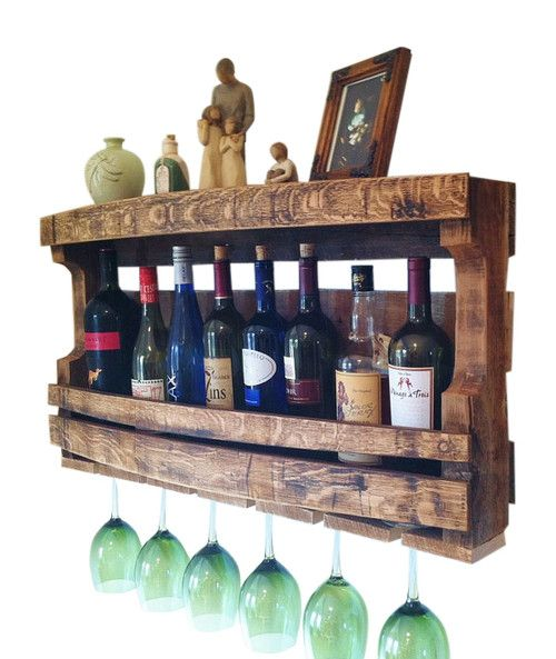 """The Napa Valley Wine Rack is a beautiful piece of Home Decor Hand Made from 100% Reclaimed Wood Wine Barrels and makes a perfect Custom Wall Decor Accent to any room. It measures 34"""" Long by 17"""" High"""