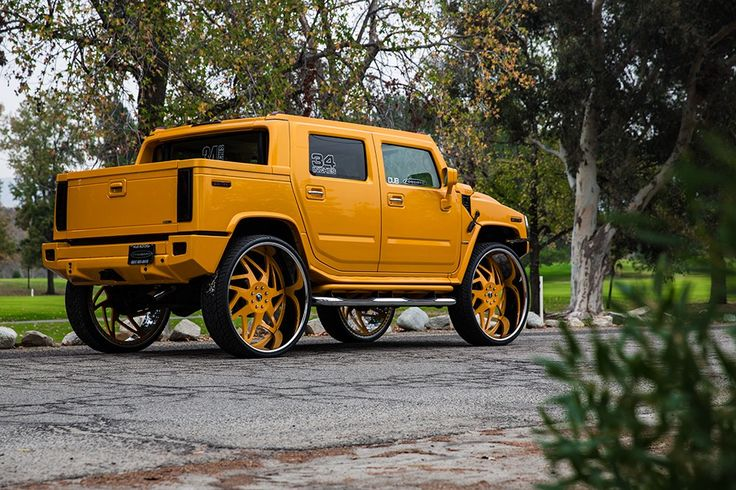 This yellow Hummer pickup is said to be the only one in the world that's been equipped with 34-inch Forgiato Finestro wheels. That's probably the second most useless world record after the most snails ever attached to a face or the longest distance traveled on a bicycle while playing the violin (yes, those are real).