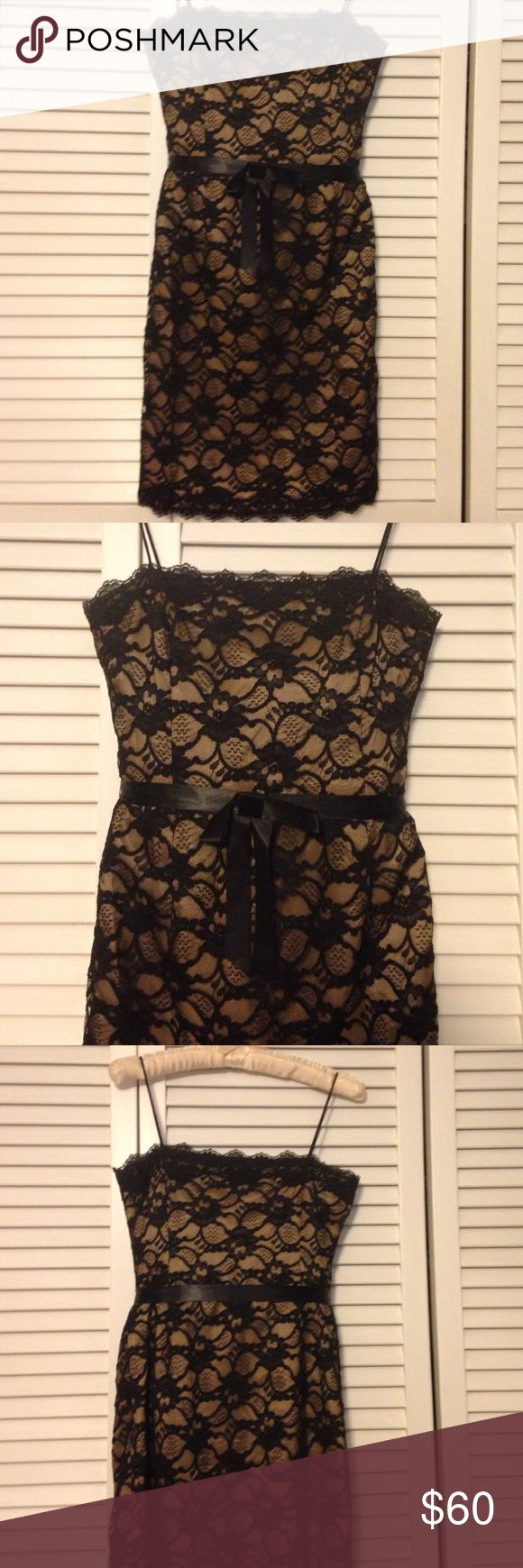 Jones New York Black and Tan lace dress Jones New York Black and Tan lace dress with black ribbon bow belt. Above the knee length. Only been worn twice. Jones New York Dresses High Low