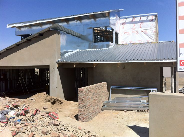 Steel Frame House - IBR sheeting for roof going up & outside plastering started. (31/09/12)