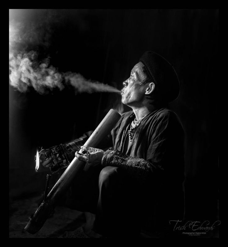 https://flic.kr/p/HpYQ8E | Relaxing with his pipe | Dao ethnic minority tribe are in northern Vietnam, customary for the men to smoke their tobacco using these long pipes made  of bamboo