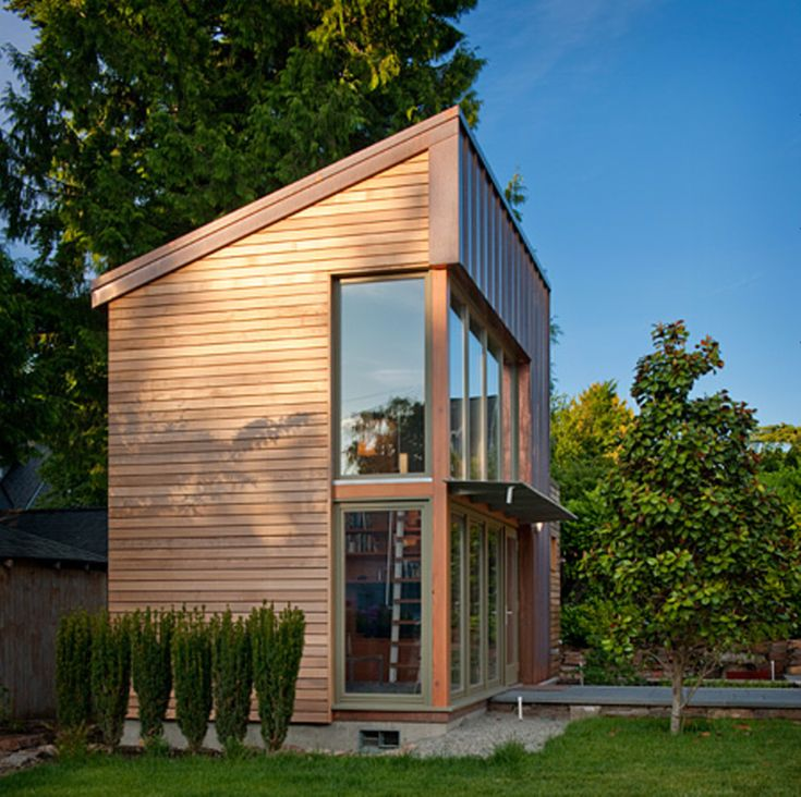 This copper glass and cedar garden pavilion serves as for House music structure
