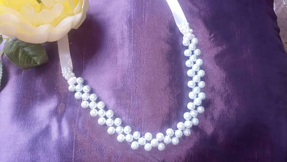 Check out this item in my Etsy shop https://www.etsy.com/uk/listing/558596819/white-pearl-handweaved-headband-with