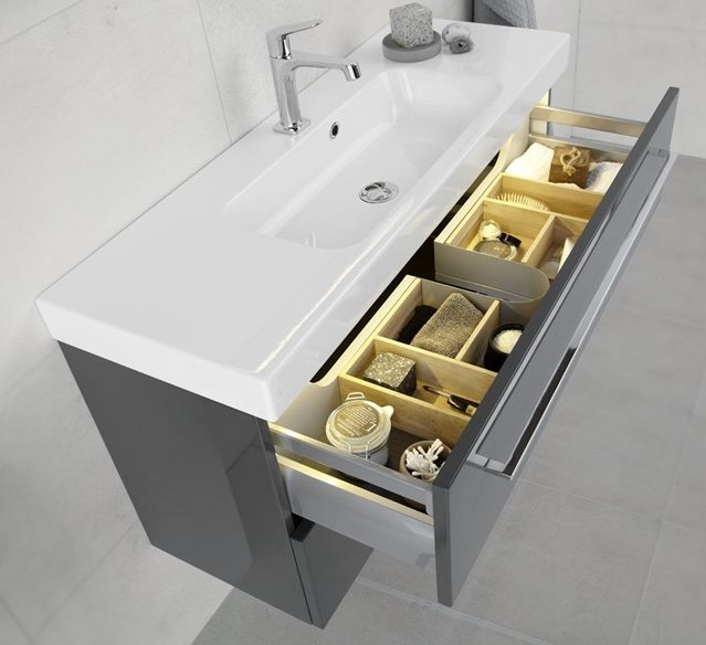 Dansani Menuet washbasin unit with storage dividers.