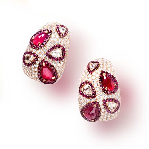 A pair of ruby and diamond earclips