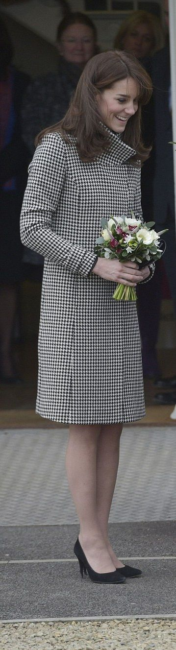 The Duchess of Cambridge wrapped up in a houndstooth Reiss coat for a visit to the Action on Addiction treatment centre in Warminster on December 10, 2015
