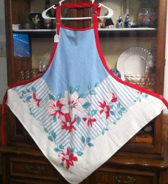 Vintage tablecloth turned into an apron. Cut on the corner, this apron is unique and cute.