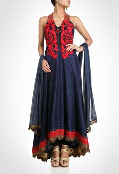 Create a stunning impression with this blue halter neck anarkali with beaded neckline. Enriching the look is the bodice intricately embroidered in an oriental pattern. The brocade hem bordered with metallic beads and chandelier lace enhances its luxurious