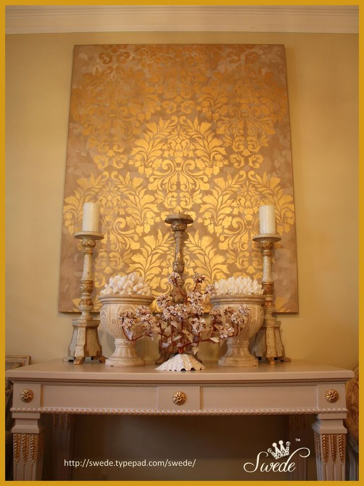 Large stenciled canvas... diy.  This looks incredible and she used spray paint,...  really,... spray paint !