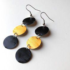 Boucles d'oreille rondes dorées et noires en capsule de café nespresso