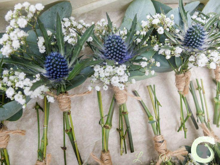 Groom & groomsmen buttonholes of gypsophila and eryngium thistle - Rustic wedding flowers - Laurel Weddings - http://www.laurelweddings.com/rustic-wedding-flowers-owen-house-barn/