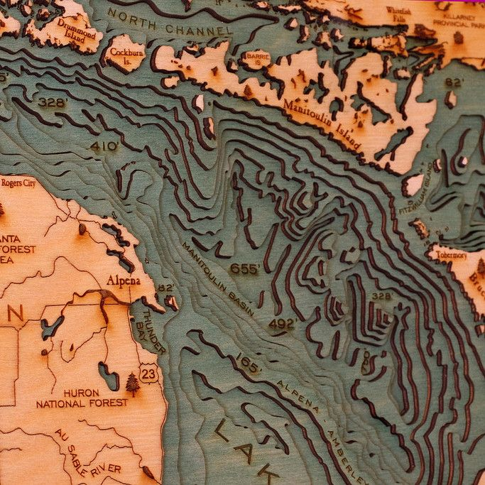 Lake Huron Locale: Michigan & Ontario Techniques: Laser-cut wood map Originally appeared on Below the Boat