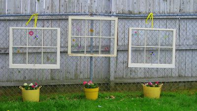 """Downtime. Upcycle.: Garden Decorations. Use old windows to decorate a chain link fence. You could potentially paint the window panes for a """"stained glass"""" effect if your neighbors do not have a privacy fence."""