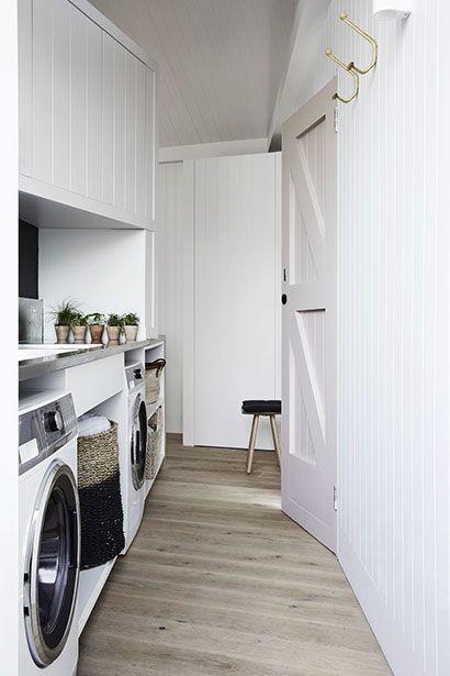 Whiting Architects | O'Grady; white vj walls, pink barn door, laundry nook