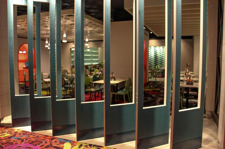 These open panels work as a bareer to separete the dining area from the casino. At the same time allow the customers of the restaurant to see the casino and vice versa.