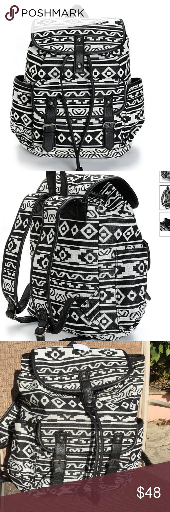 """Black and White Print w Black Trim Rucksack. NWT. Black and white print canvas rucksack backpack with black synthetic leather trim. Taffeta lining with cinch top and magnetic snap closures. Lightly padded adjustable shoulder straps and top handle loop. 14""""H x 15""""W x 6""""D.  60% cotton, 40% polyester. NWT. Zippered inside pocket for your phone and keys. Outside pocket 7""""H x 9""""W x 2"""" D. Bags Backpacks"""