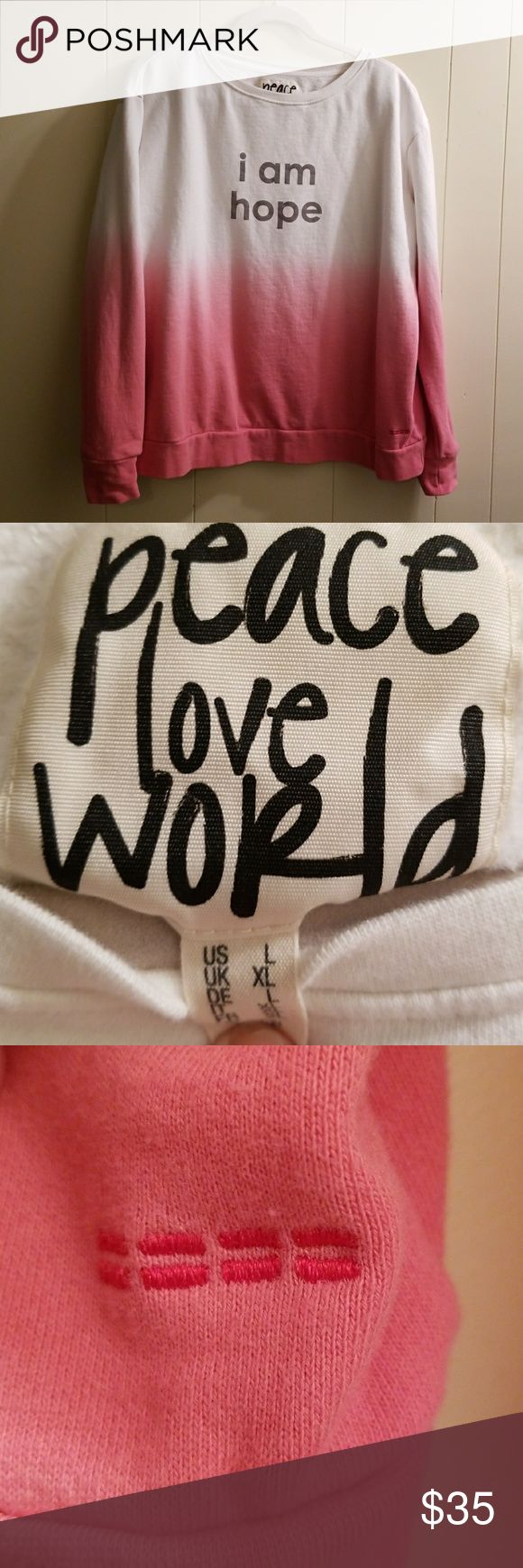 Authentic new peace love world sweatshirt Size XL.. never worn soft and warm starts out white changes to pink Peace Love World Sweaters