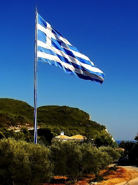 Keri cape Zakynthos - The largest Greek flag. Guiness world records: 18,1 x 36,9 = 667,89 m2. In the background is Keri lighthouse.